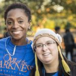 Two women posing at an Out of the Darkness Walk